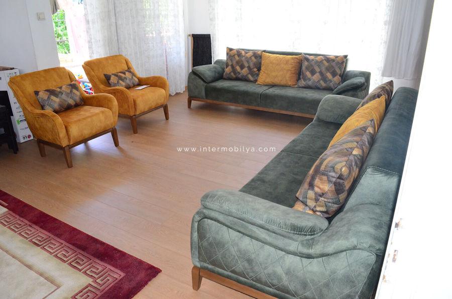 Urey ailesinin yeşil-hardal renklerdeki modern oturma grubu