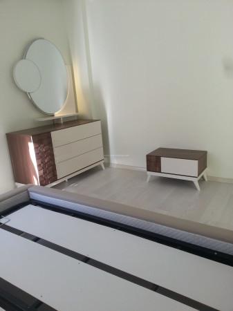 Özyurtseven ailesinin ekru-ceviz tonlarında modern yatak odası - Thumbnail