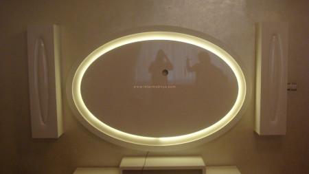 Çelik ailesinin elips formundaki krem renkli tv ünitesi (1)
