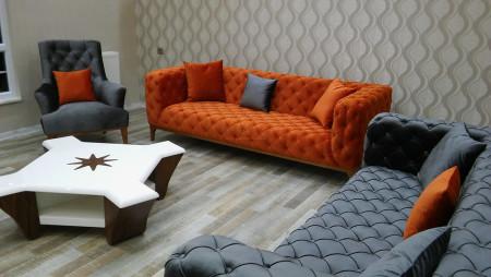 Sönmez Ailes'inin turuncu antrasit kombinli chester koltukları